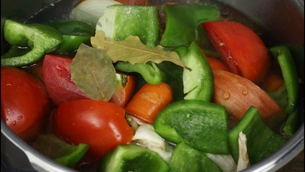 vegetables in a large  pot with water